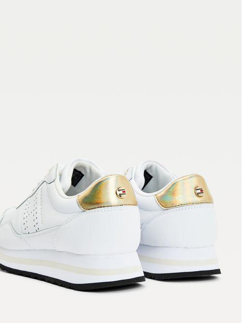 Zapatillas de piel con detalles metalizados